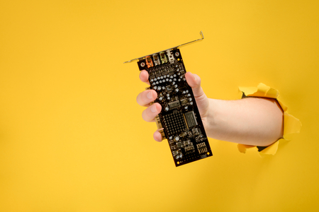 Hand taking a circuit board