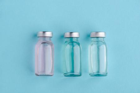 Three vials of different medicines