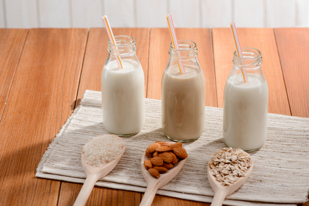 Bottles of plant-based milk Stockfoto