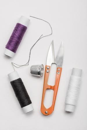 Thread, needle, thimble and scissors 写真素材