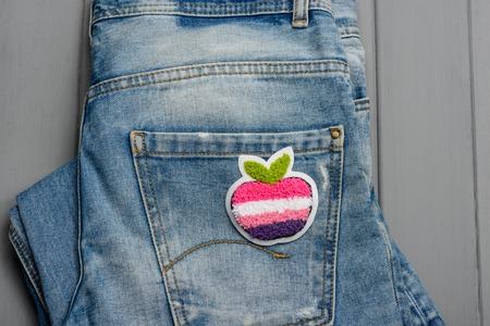 Apple fabric patch on denim