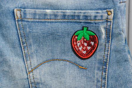 Strawberry sequin patch on pocket Stockfoto