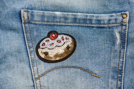 Sequin patch on jeans pocket