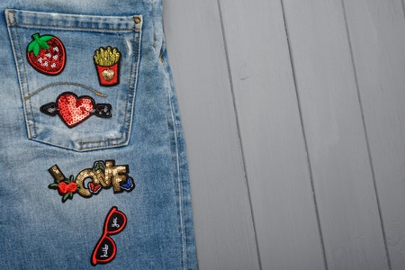 Repaired jeans with various patches