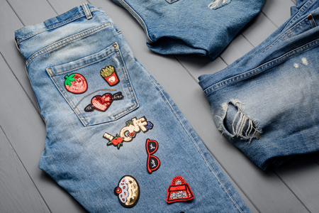 Jeans with various patches