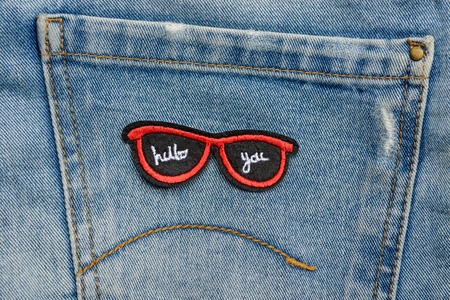 Red sunglasses embroidered patch Stock Photo
