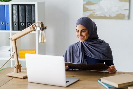 Muslim woman working in office Stock fotó