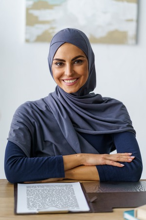 Muslim woman with radiant smile Stock Photo
