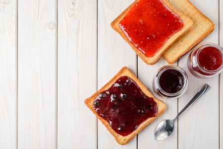 Toasts with jam on table Stockfoto
