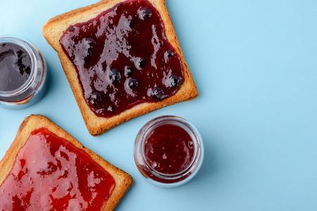 Toast with jam on blue