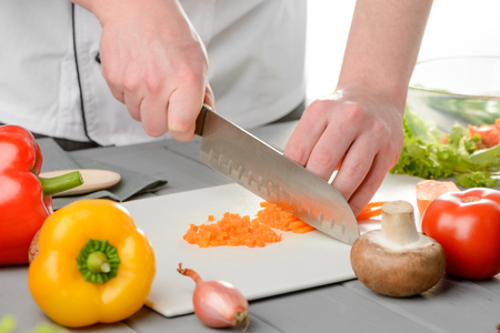 Chef dicing a carrot Stock Photo