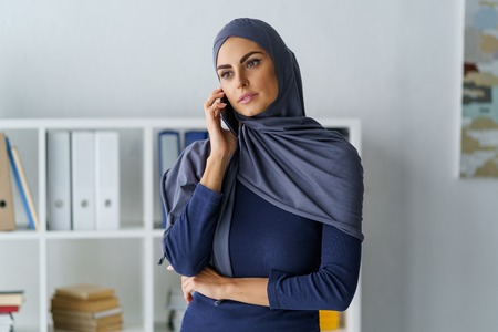 Female manager talking on phone