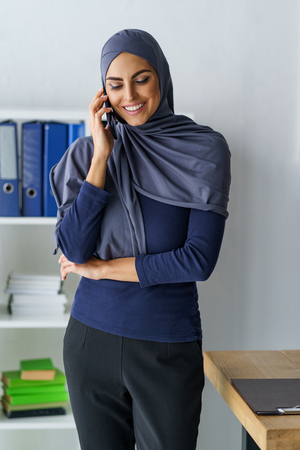 Arabian woman talking on phone