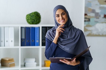 Muslim business lady got interested Stock Photo