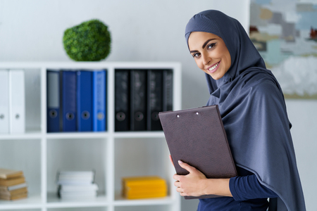 Cheerful woman in the office Stockfoto