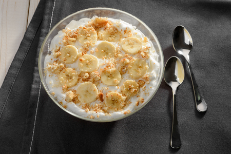 Bowl of cream and banana