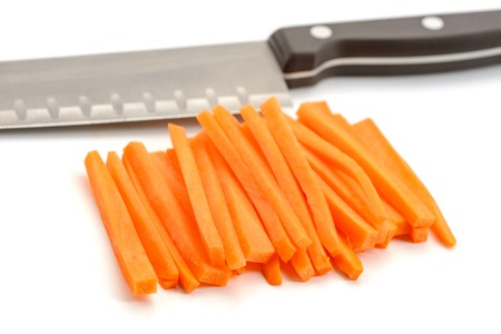Santoku knife and carrot sticks Foto de archivo - 120815515