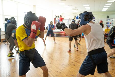 Fighters exercising with sparring partners Imagens