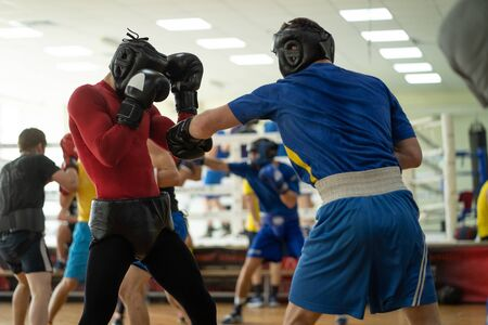 Boxing fighters training at gym Stock Photo