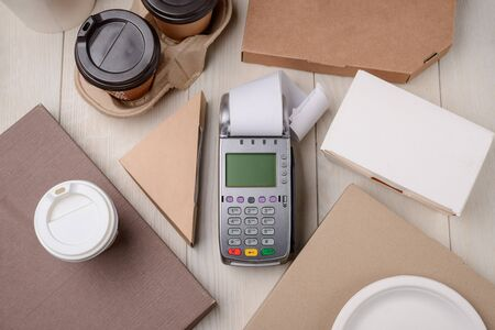 Payment terminal between paper boxes