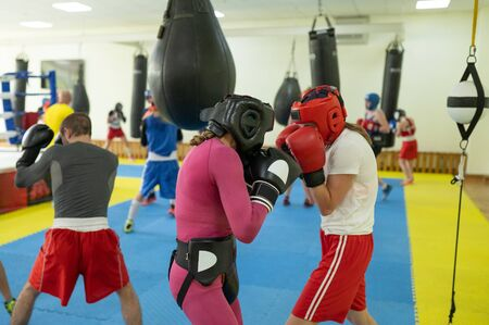 Female boxing fighters exercising
