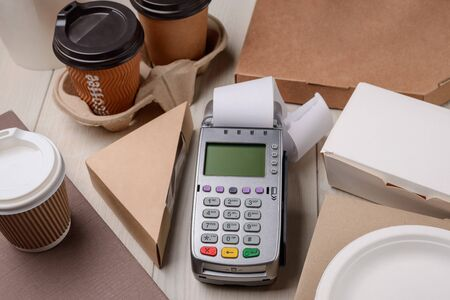 Paying for coffee and food Imagens
