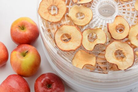 Apples and dried slices Imagens