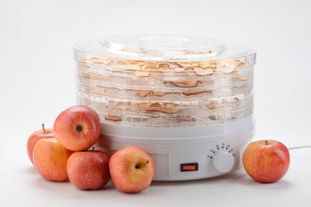 Whole apples and a dehydrator