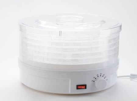 Electronic multi-rack dehydrator on white background. Modern kitchen equipment.