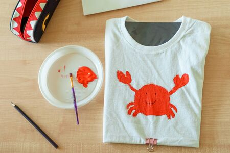 Red crab on white t-shirt