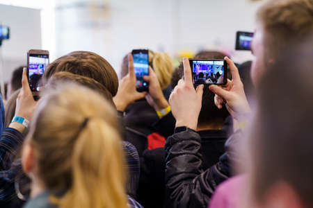 People recording video on phone