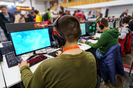 Back view on professional gamers