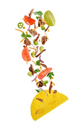 Flying ingredients of hard-shell taco