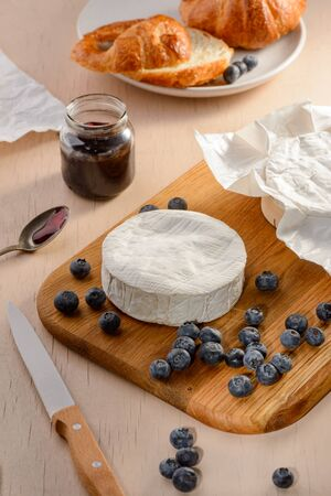 Camembert, blueberries, jam and croissant