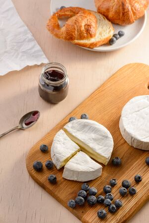 Brie cheese, blueberries and croissant Stock Photo
