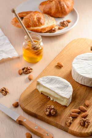 Brie cheese, nuts and honey Stock Photo