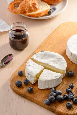 Brie cheese, blueberries Stock Photo