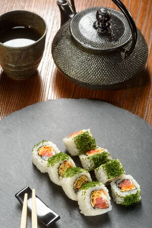 Teapot and smoked salmon rolls 스톡 콘텐츠