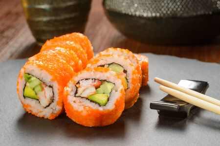 California sushi rolls and chopsticks