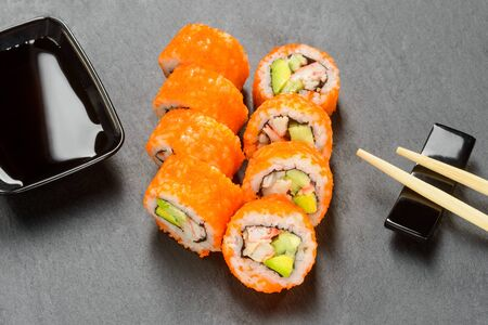 Sushi rolls and soy sauce