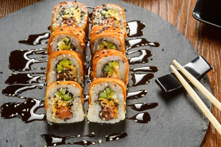 Sushi rolls sprinkled with sauce