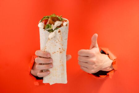 Hand holding a doner Stockfoto