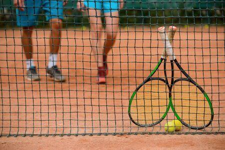 Rackets and balls near net. Low section shot. Banco de Imagens