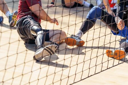 Amputee athletes playing sitting volleyball. Professional players . Banco de Imagens