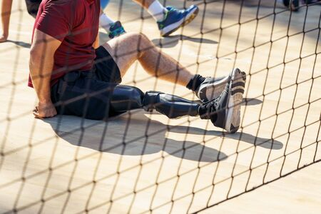 Parasporstman sitting during a volleyball match.Professional players . Banco de Imagens