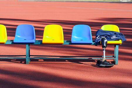 Row of colorful stadium seats and sportsman's clothes