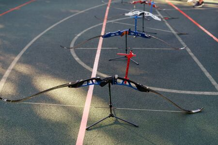 Bows prepared for competition, waiting for shooters. Archery sports.