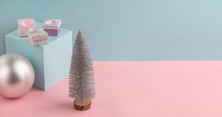 Christmas fir tree, cube stand, silver ball and little gift boxes