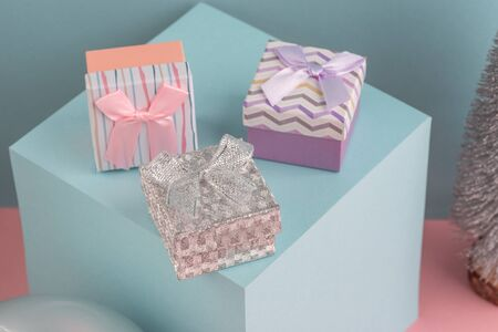 Fir tree, cube stand, silver ball and little gift boxes