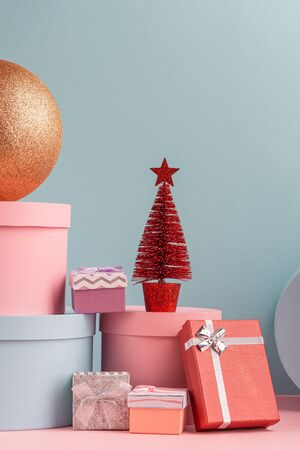 Lot of various gift boxes, balls and red firtree on teal background Stock Photo